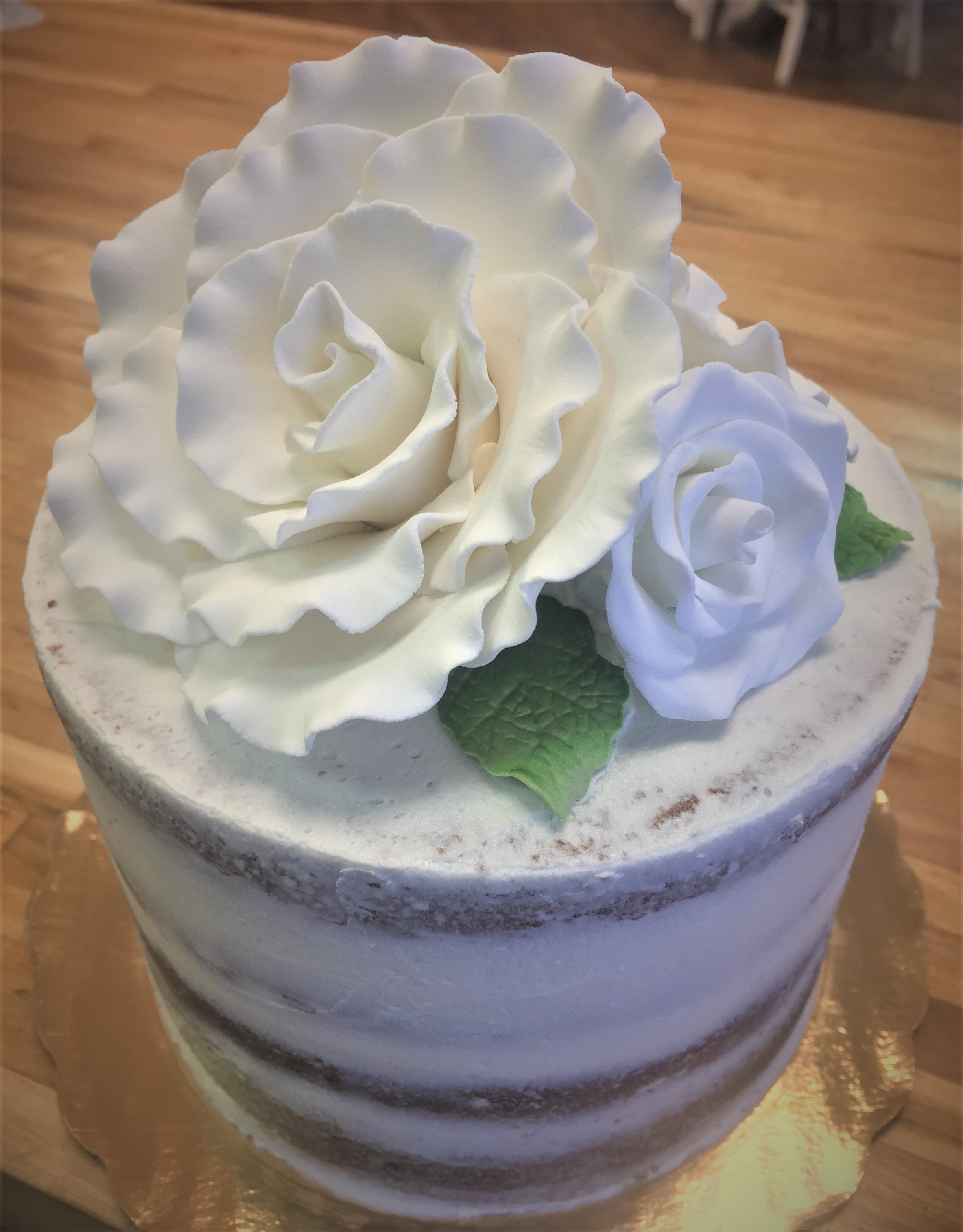 Gateaux Bakery & Cafe Rustic Cake Lightly Frosted Buttercream with Flowers.JPG