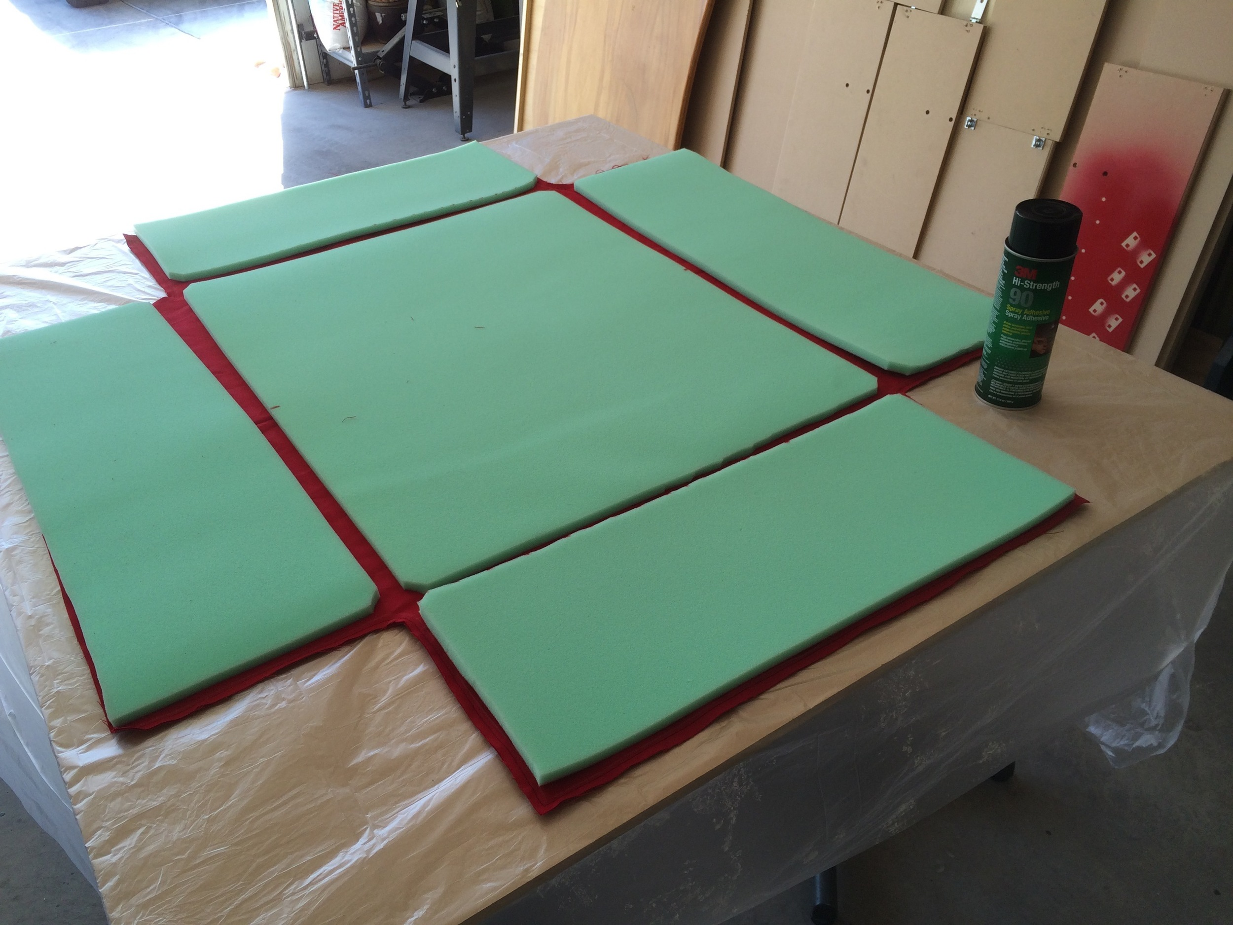 Foam being glued into inside-out padding cover fabric