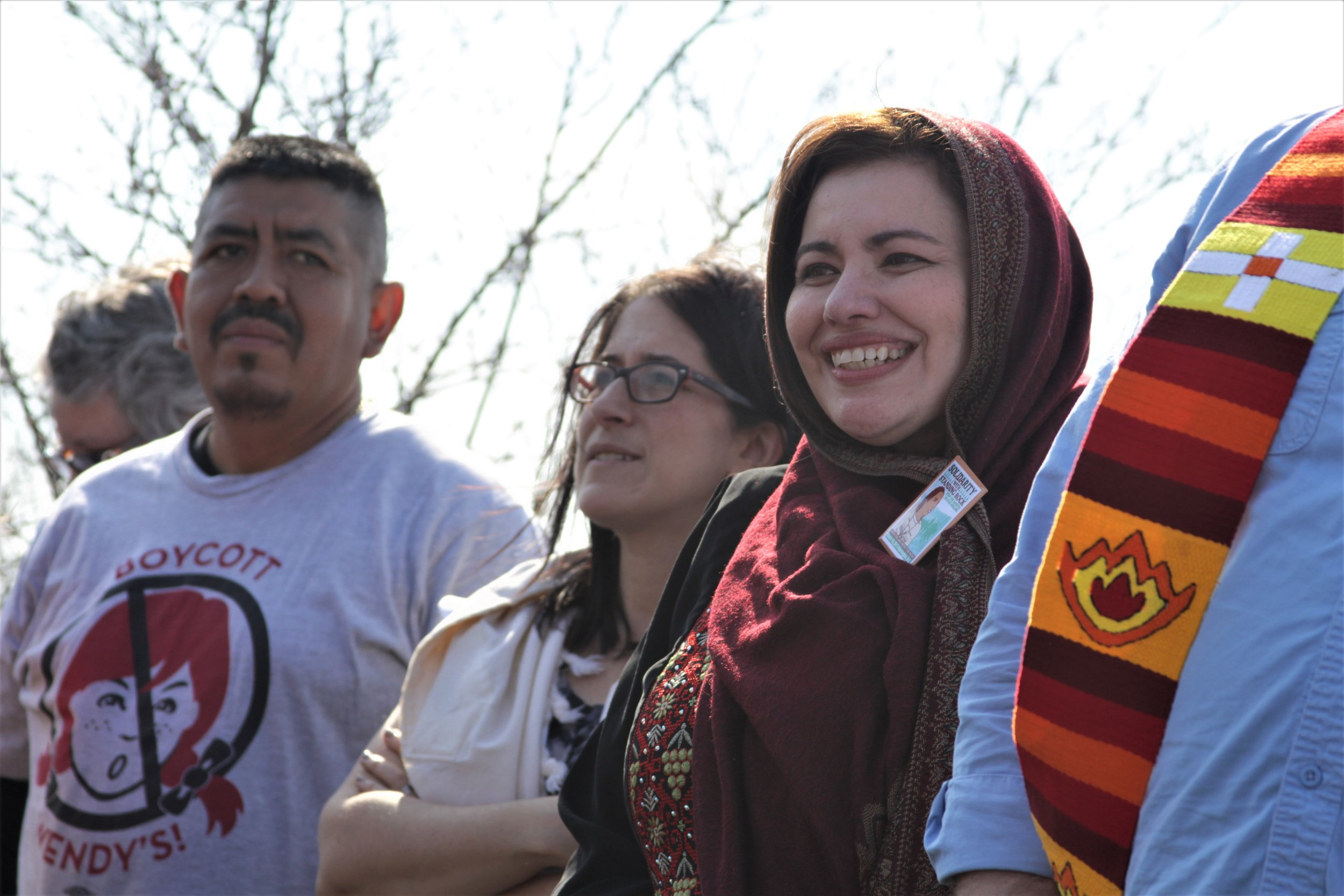 CIW's Lucas Benitez joins Rachel Kahn-Troster, Director of Programs for T'ruah and Sahar Alsahlani, Board Member of the Council on American Islamic Relations (CAIR) to welcome the nearly 100 gathered for a vigil outside Wendy's headquarters in Dublin, OH