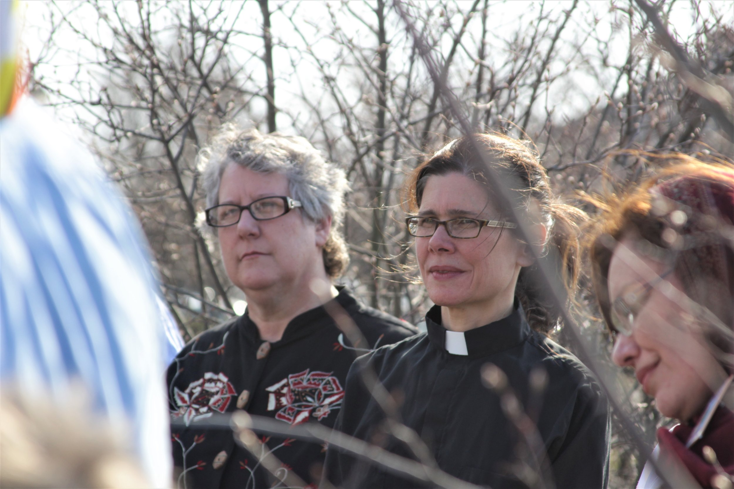 Julie Taylor, Executive Director of Wendy's Boycott endorser National Farm Worker Ministry (LEFT), listens to fellow leaders after sharing inspiring words with the fasters and allies alongside longtime supporter Rev. Noelle Damico