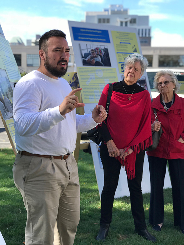 Alliance for Fair Food's Uriel Perez leads congregants through the museum's panels, detailing sexual violence in agriculture as well as the solution provided by the Fair Food Program.