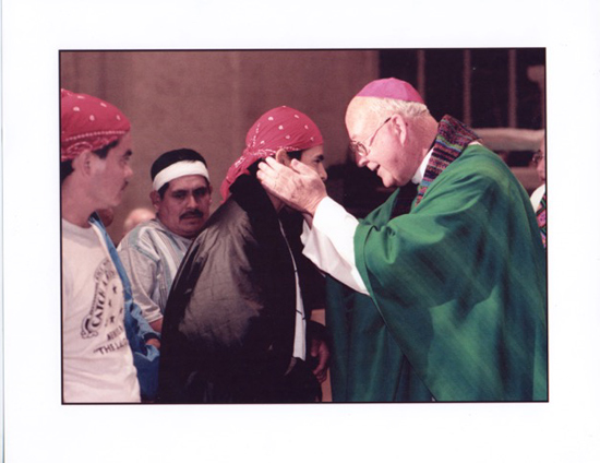 CIW hunger strikers receive communion from the late Bishop John Nevins in January of 1988 in a ceremony breaking their historic month-long fast in Naples, FL.