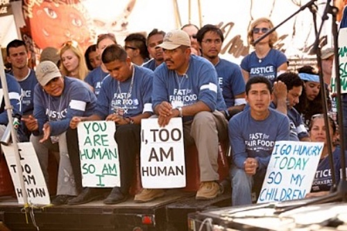 CIW members and allies gather at the breaking of their week-long fast outside Publix headquarters in Lakeland, FL, in 2012.