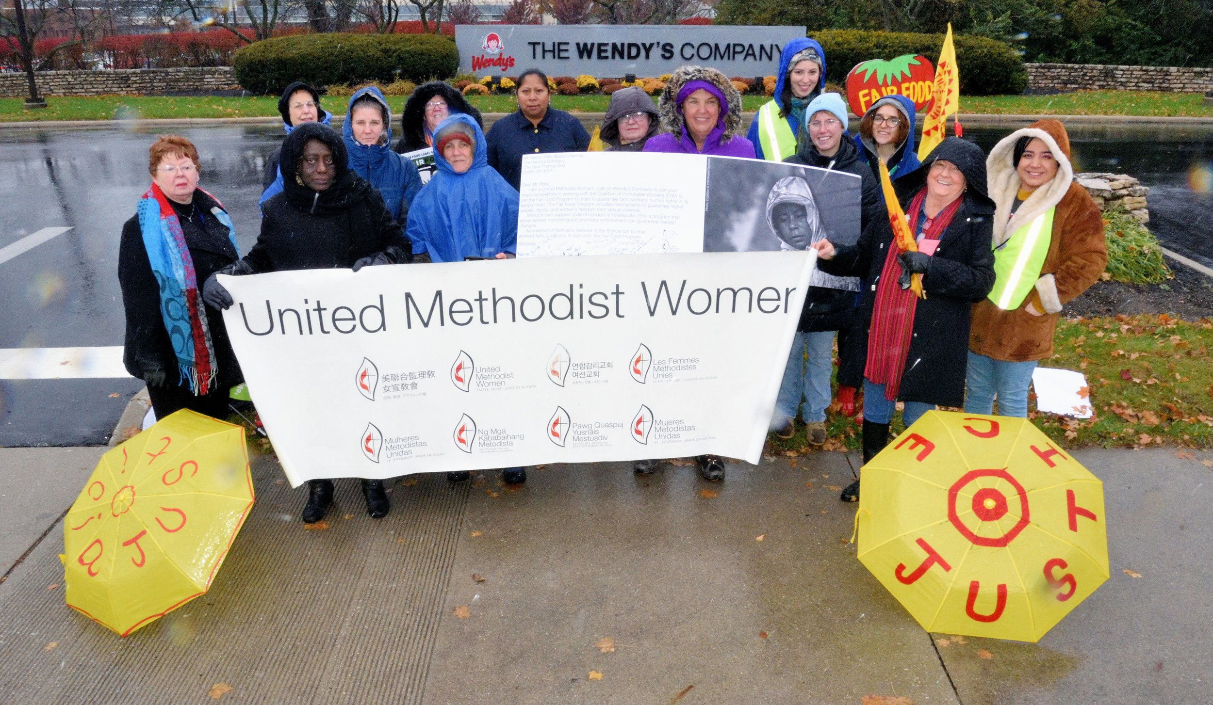 The delegation of United Methodist Women, local Columbus area faith leaders and students outside of the Wendy's HQ.