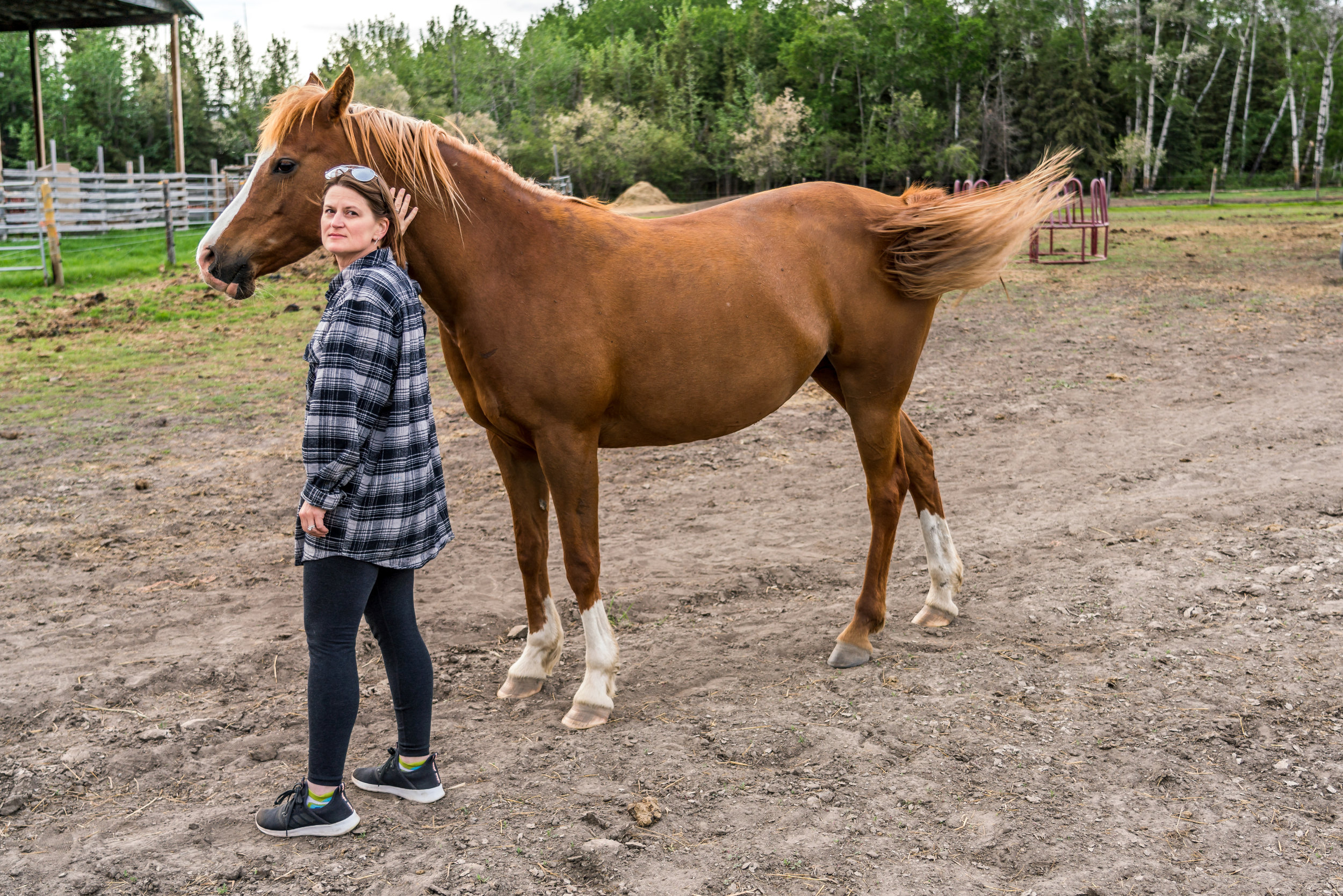 Annita with one of her uncles horses