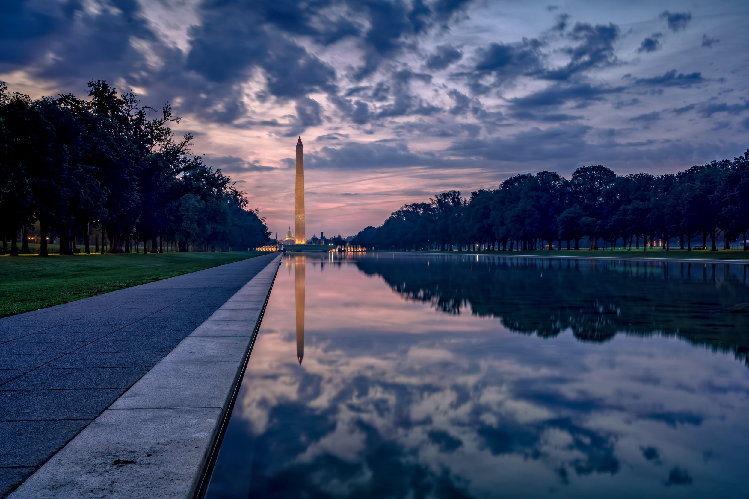 Amazing reflection, texture in the clouds, and nice pink early morning light. Around 5:20am at the Lincoln Reflecting Pool