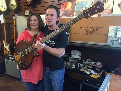 Courtesy of Carl Radle Com - That's Carl's daughter with his Alembic