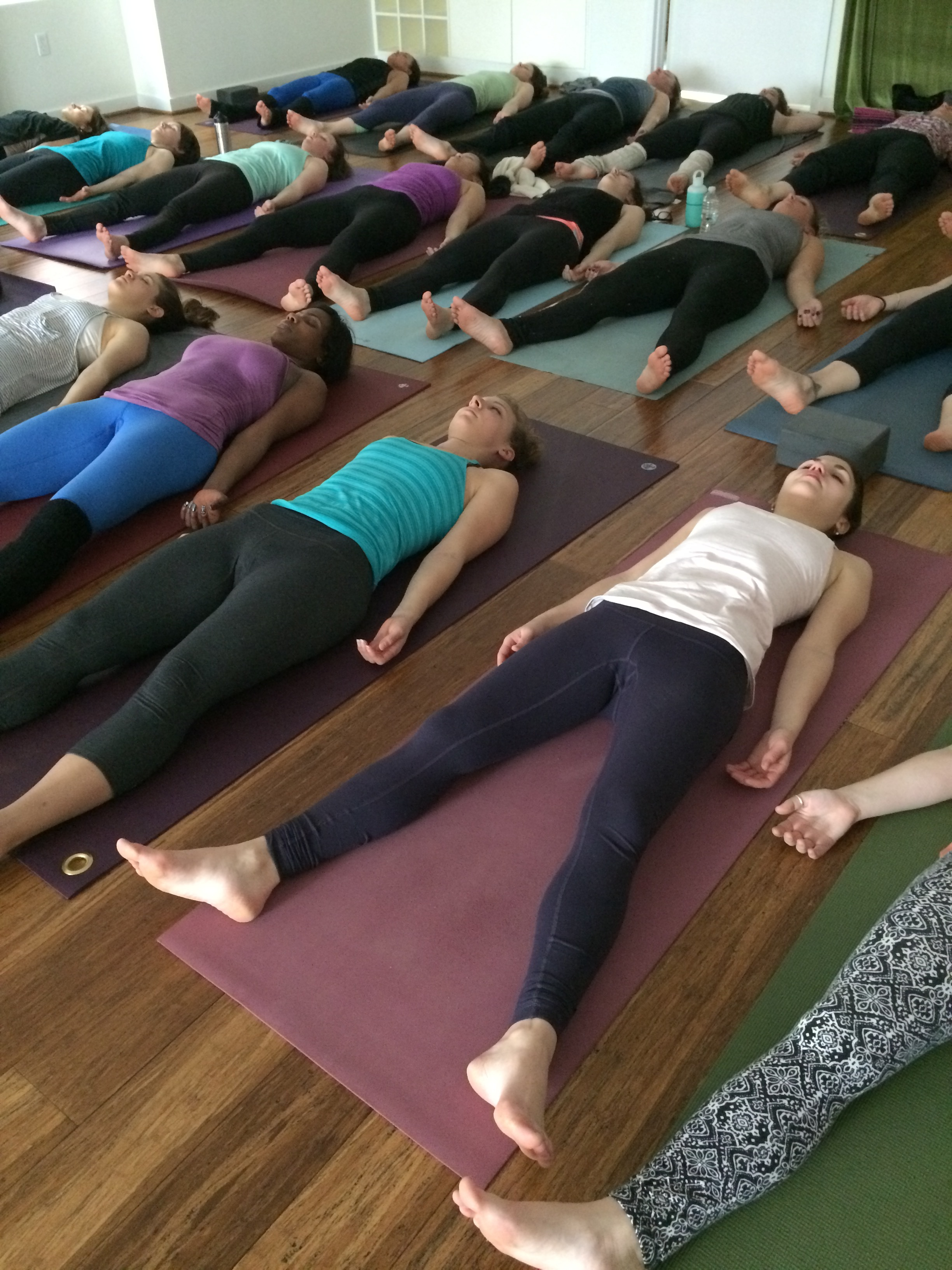 Relax deeply in savasana at Flow.