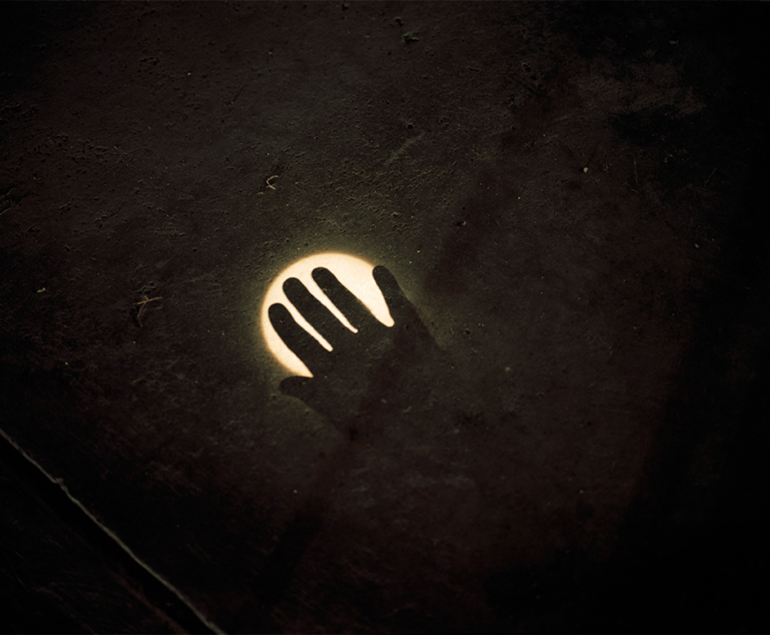 Image of sun cast by hole in hangar roof