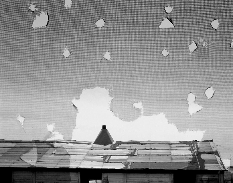 Holes torn in window screen, airmen's barracks