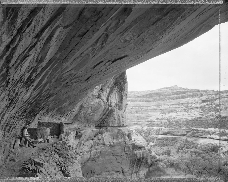 Ed Abbey taking notes in Turkey Pen ruins, Grand Gulch, Utah, 1988