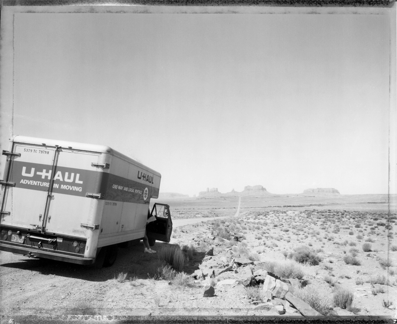 Checking the road map: crossing into Arizona, Monument Valley, 1982