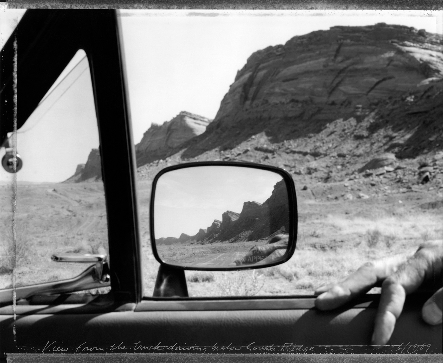 View from the truck: driving below Comb Ridge, 1989