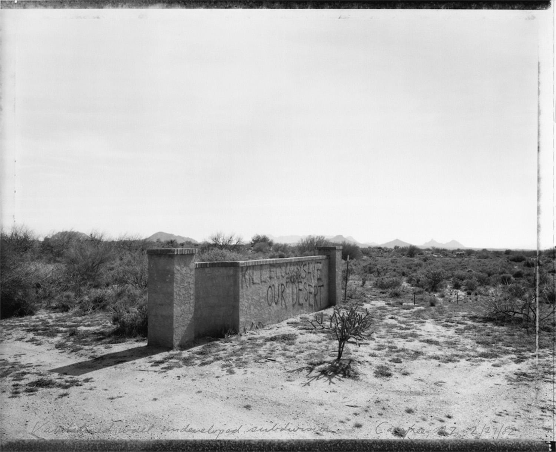 Vandalized wall, undeveloped subdivision, Carefree, AZ, 1982