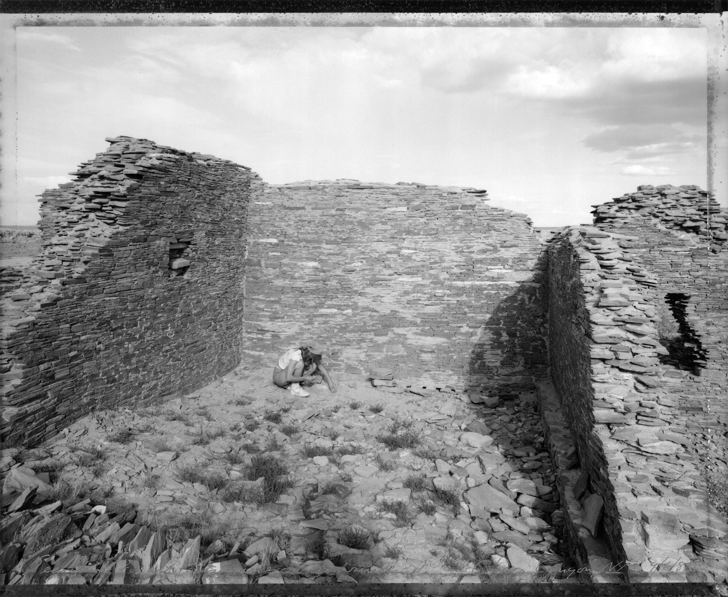 Searching for artifacts, unexcavated ruins, Chaco Canyon, New Mexico, 1982