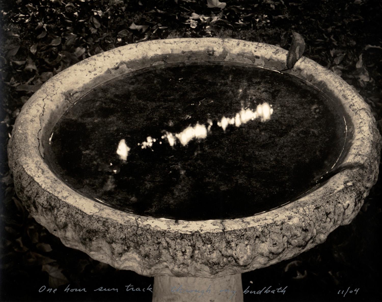 One hour sun track through my birdbath, 2004