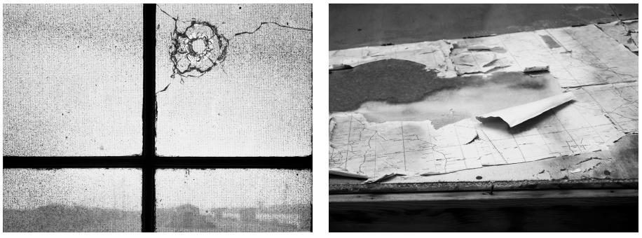 Bullet hole, barracks window; Torn air charts, former office