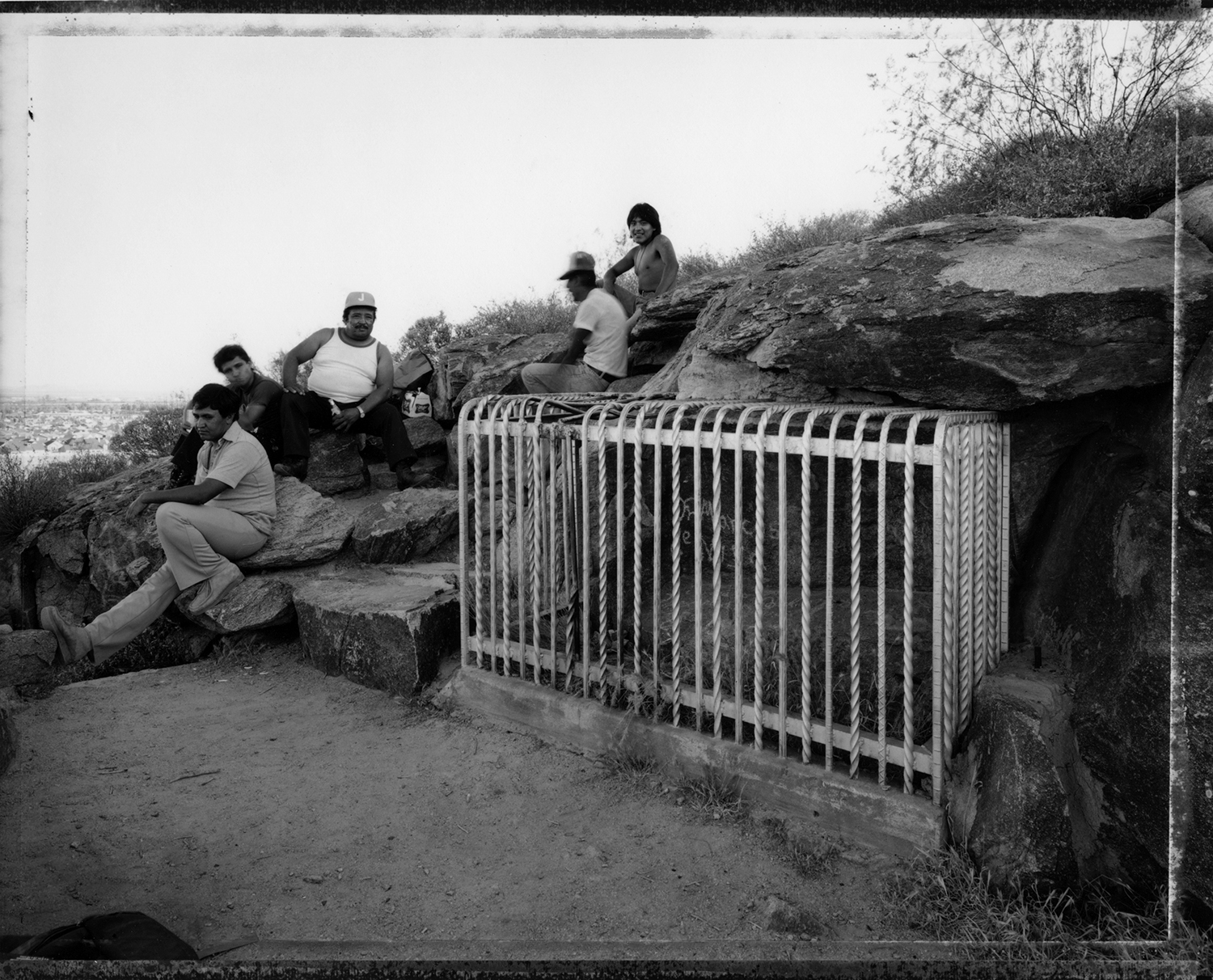Mexican migrants drinking beer at the site of an inscription by Fr. Marcos de Niza, 1990