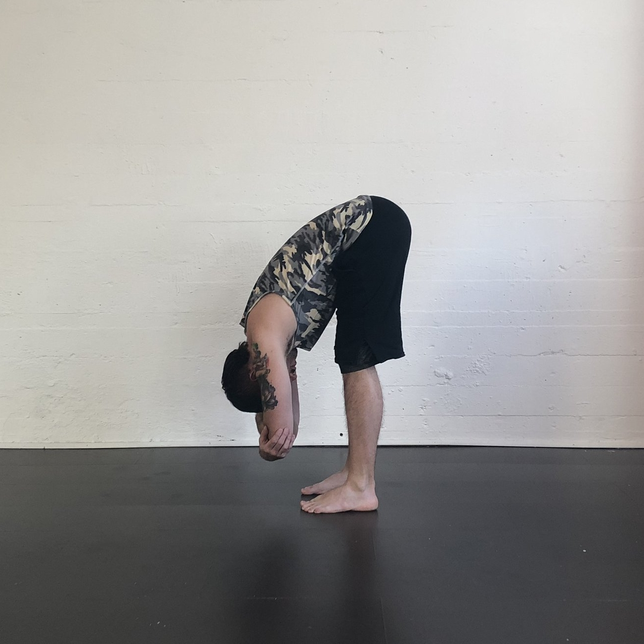 Ragdoll  - Stand with your feet wider than your hips.  With your knees bent, hand your torso over your legs.  Hold opposite elbows and drape your spine down your legs.  Allow your spine to length and close your eyes. Let each breath lengthen and loosen and release tension