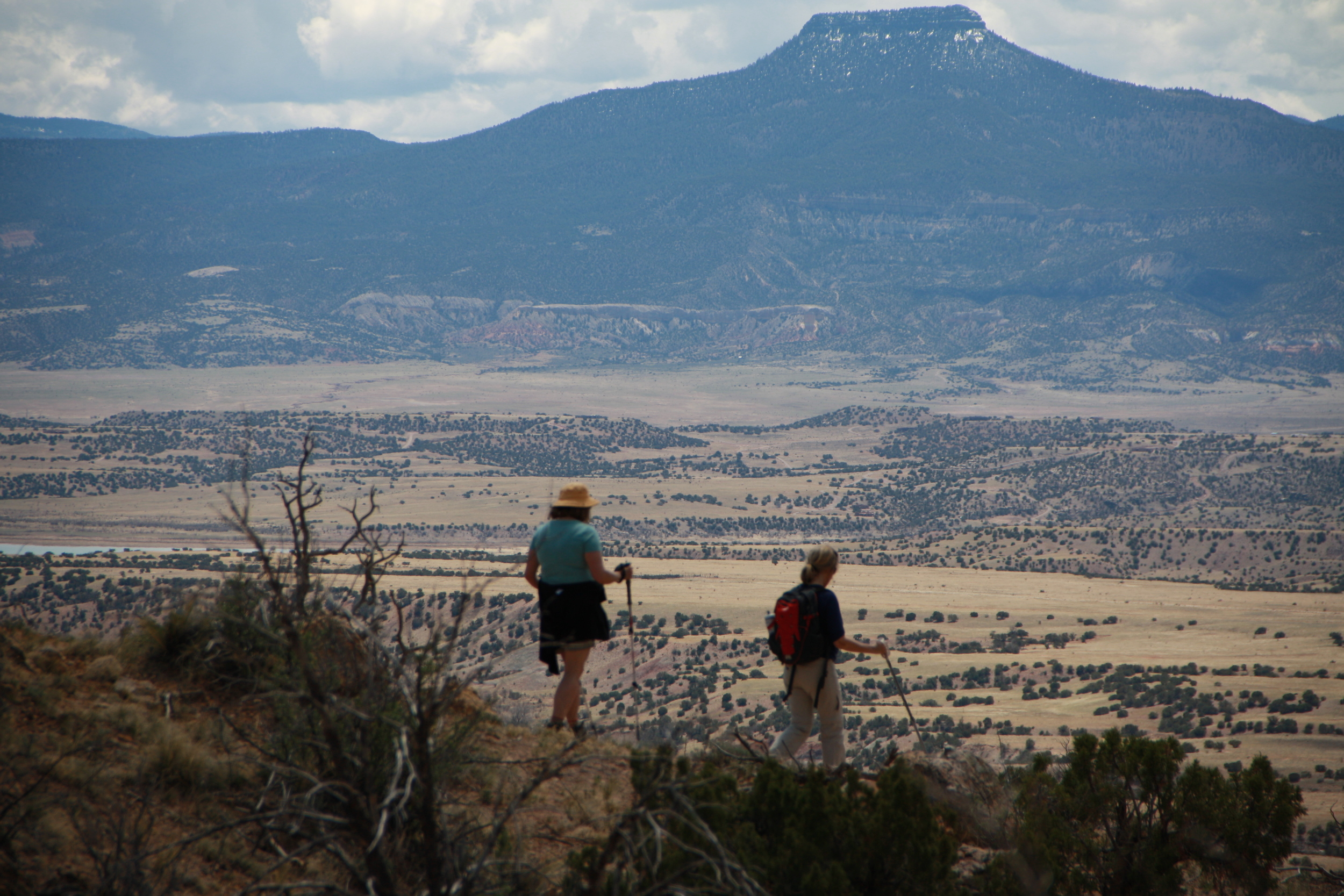 The Chama valley stretches below Margaret and Molly, with the snowy heights of Pedernal watching over.