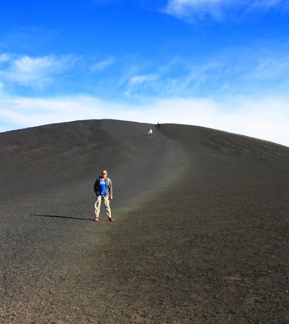 A cinder cone hundreds of feet tall. Whatever finally decides to grow there will have to contend with ferocious winds!