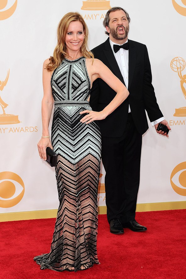 Leslie Mann and her husband Judd Apatow pose for pictures on the red carpet in 2013.
