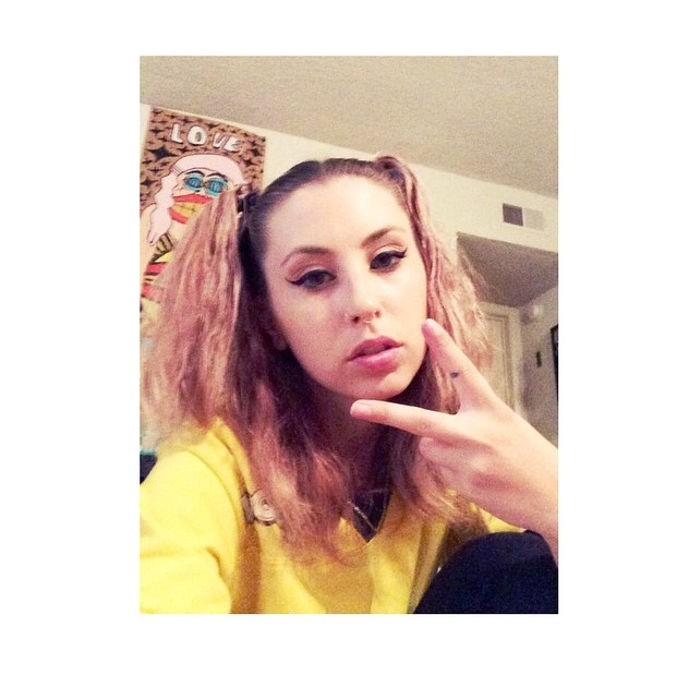The talented Kreayshawn in front of a Goons peice in 2014.