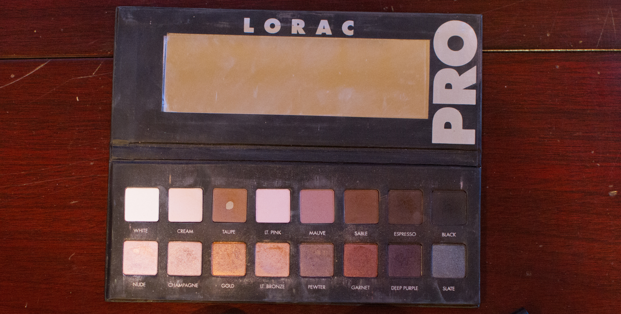 For the crease I blended out Taupe (an obvious go to) from the Lorac Pro palette. Then I mixed Espresso and black for the outter V of the eye.