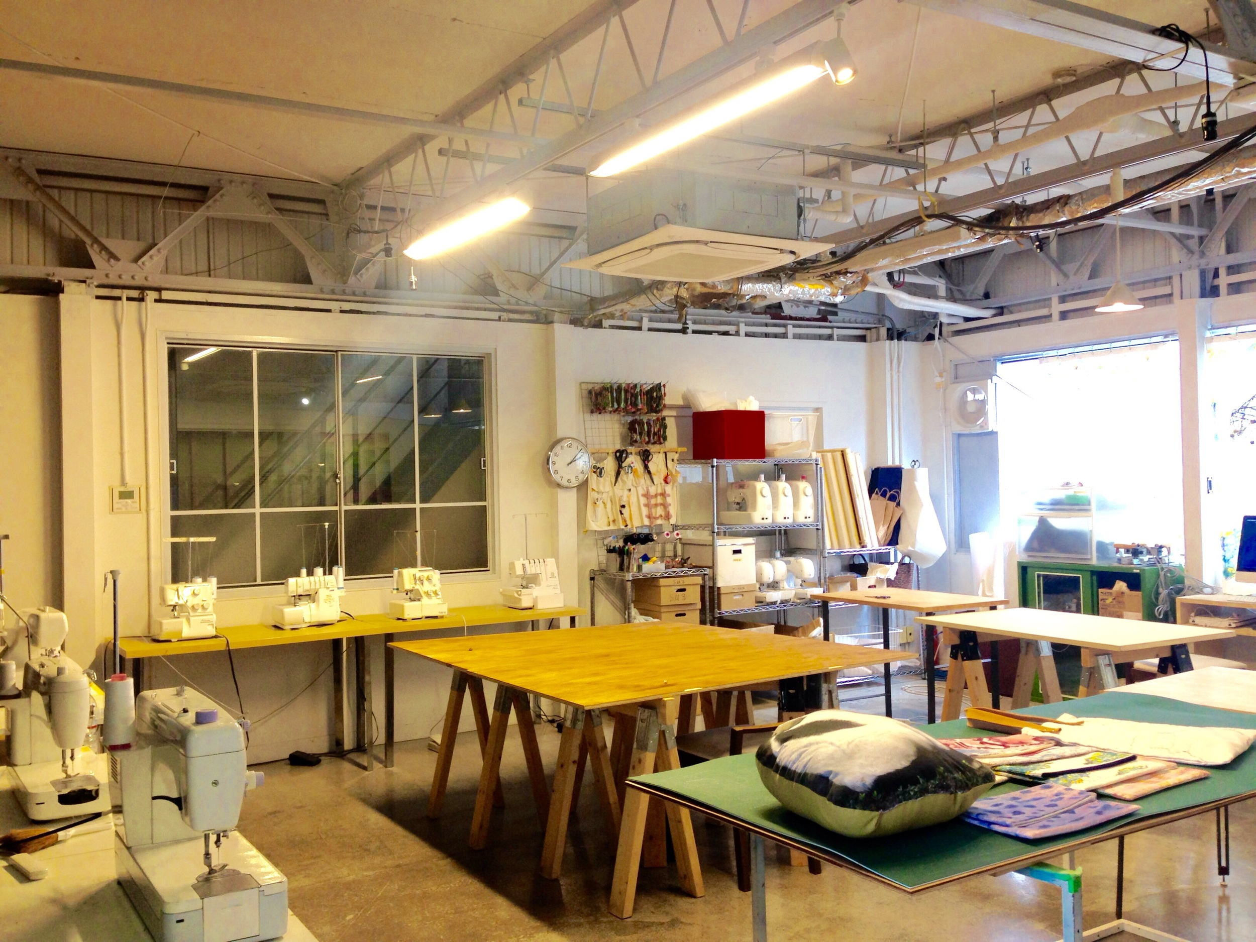 Fabric workspace with sewing and embroidery and fabric printing machines