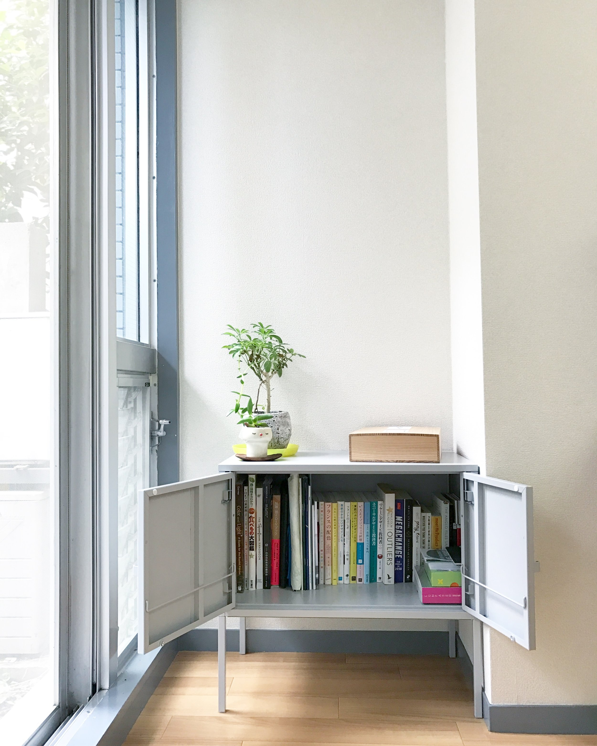 The little book corner with a compact  LIXHULT cabinet keeps my books free from dust and dirt.