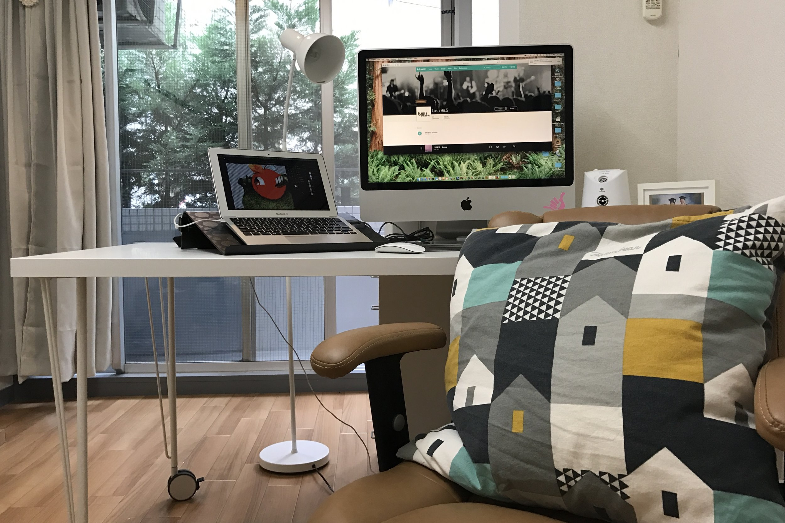 The desk put together with KRILLE legs and  LINNMON 200cm table top with a laptop stand with  BRADA laptop support .