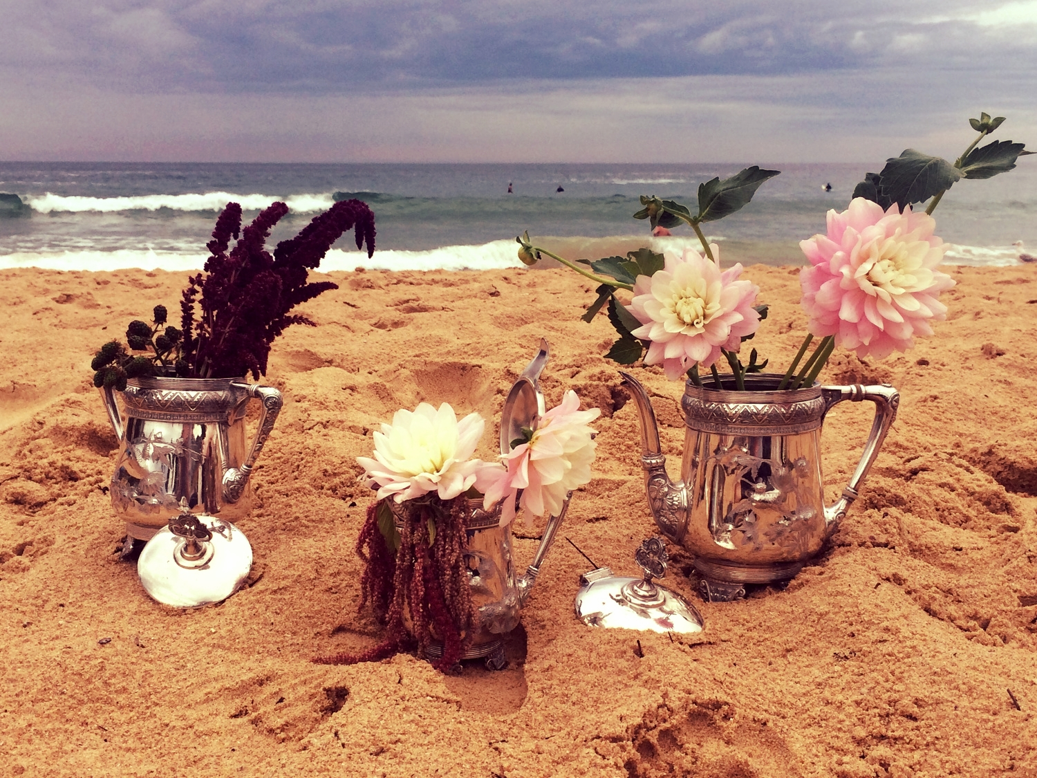 Surfers at Queenscliff Beach surrounded by a touch of vintage. Dahlia's, amaranthus & black berries dance upon the sand.