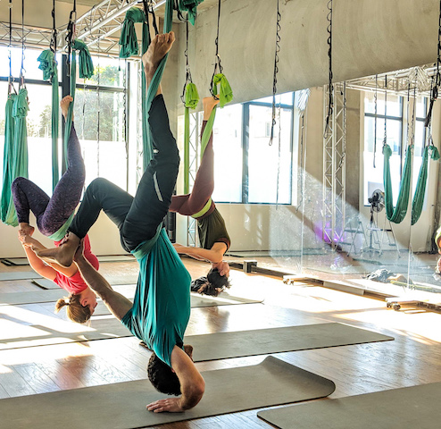 Trying out some aerial yoga inversions.