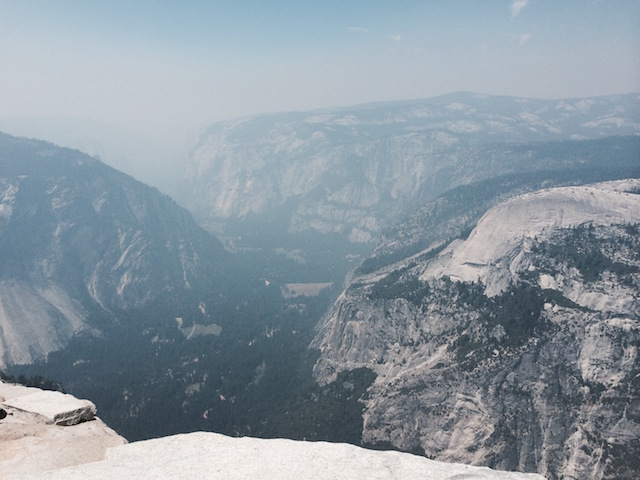 Views of the entire valley can be enjoyed from the top of Half Dome as seen in this photo. I summited this on a very smokey day during the summer of the Rim Fire (2014) which destroyed a lot of the park.