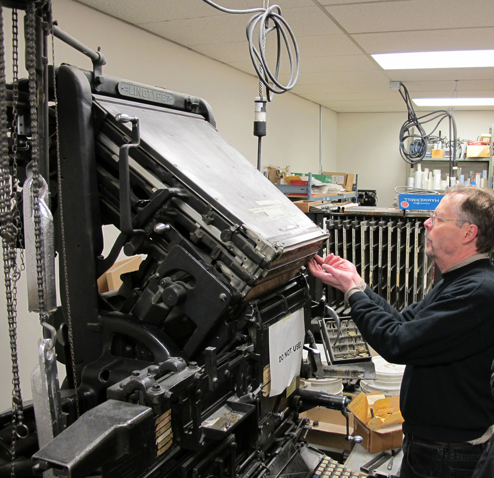 """Brian Donnell operating a 6 pocket, """"2 in 1"""" Linotype 31 at Advanced Letterpress in Portland, Oregon"""