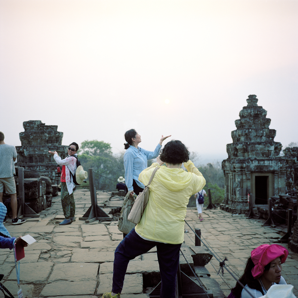 Tourists posing for a photo as the sunsets at Phnom Bakheng on April 10th