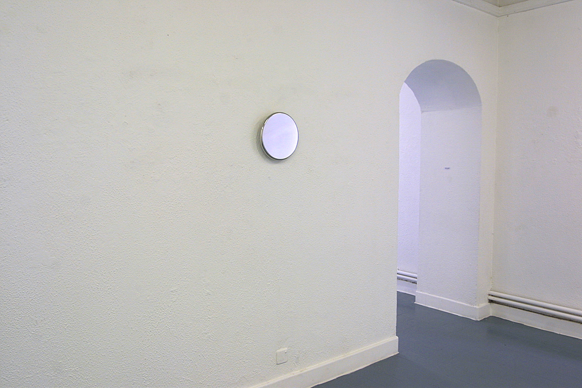 Double – two wall-mounted stainless steel disks on opposite walls facing each other  Double - large disk  2003  stainless steel  29 x 2 cm  installation viewButler Gallery, Kilkenny, Ireland, 2003