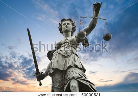 stock-photo-justice-statue-with-sword-and-scale-cloudy-sky-in-the-background-50000521.jpg
