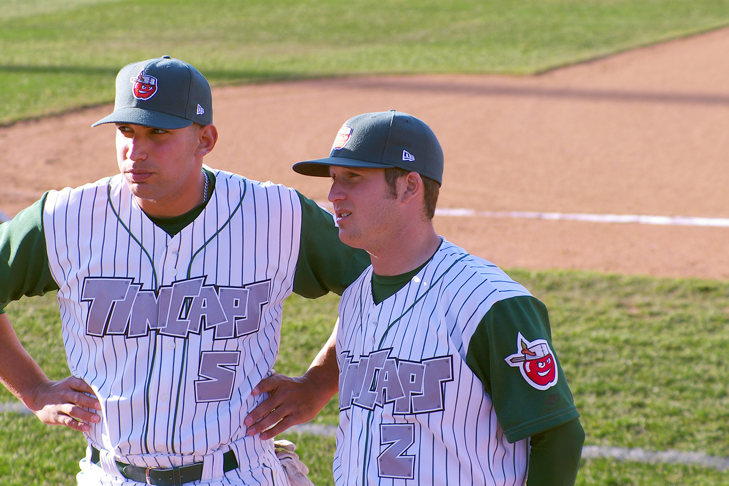 TinCaps Home Uniform 2 players.jpg