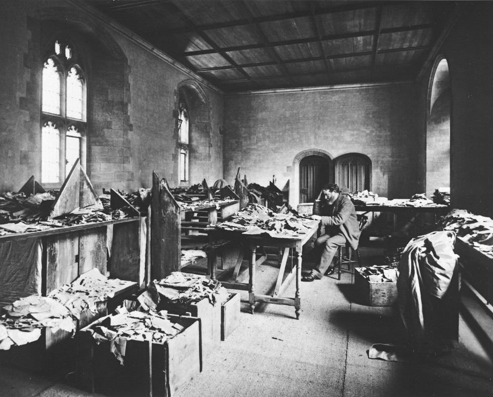 Solomon Schechter at work, in Cambridge, on the Cairo Genizah fragments |Cambridge, 1898 |Ori ginal photograph image