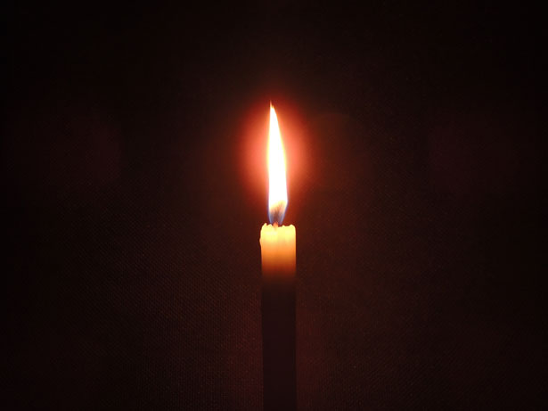 Candle burning .License: CC0 Public Domain