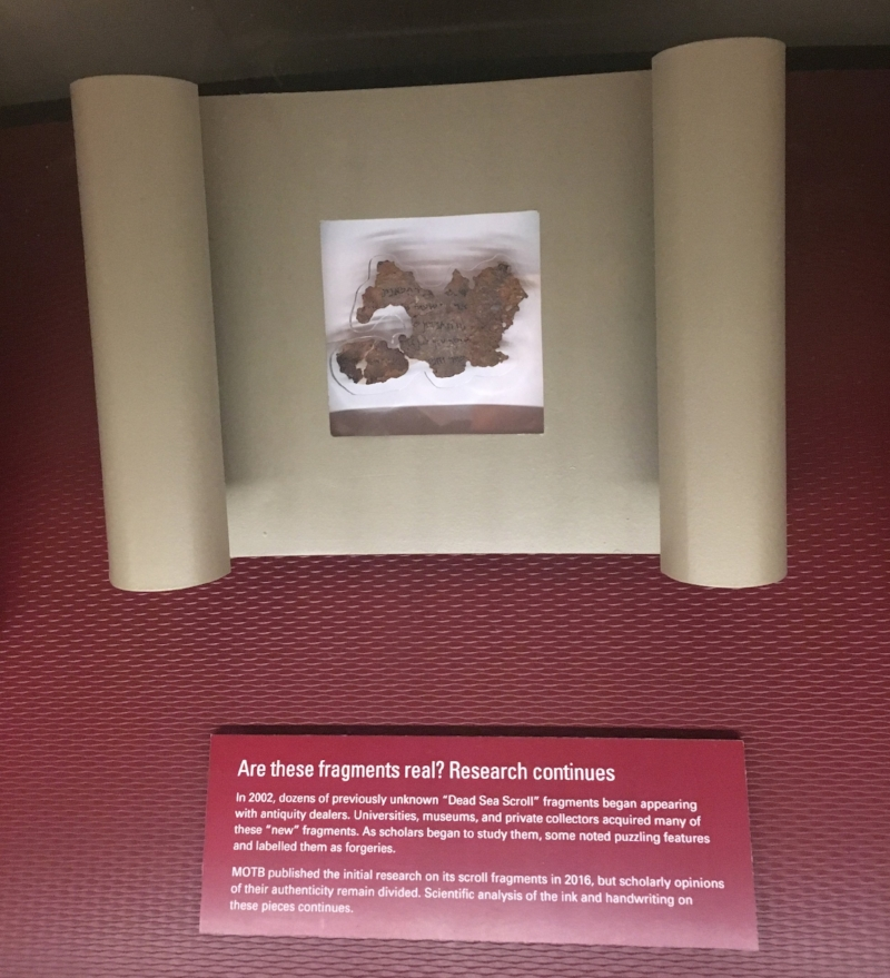 """One of several fragments in the Dead Sea Scrolls exhibit captioned with """"Are these fragments real? Research continues."""" (Photo courtesy of author)"""