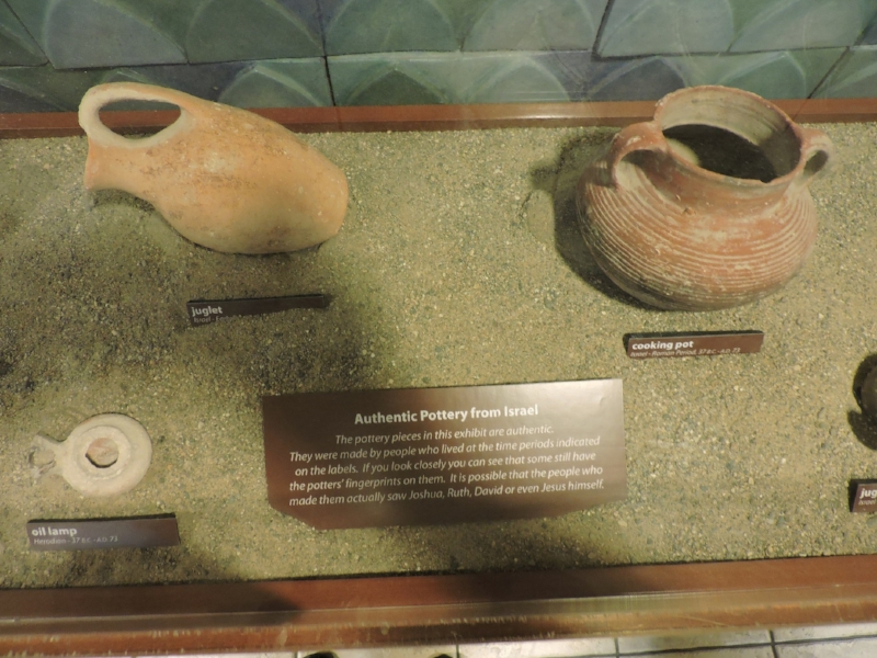 "Fig. 2. ""Authentic Pottery from Israel"". This Creation Museum exhibit features artifacts from the Middle Bronze Age to the Herodian Period. The placard says in part, ""If you look closely you can see that some still have the potters' fingerprints on them. It is possible that the people who made them actually saw Joshua, Ruth, David or even Jesus himself."" These artifacts are not attributed to the Green Collection or MOTB.  Photo by the author, Oct 2, 2015."