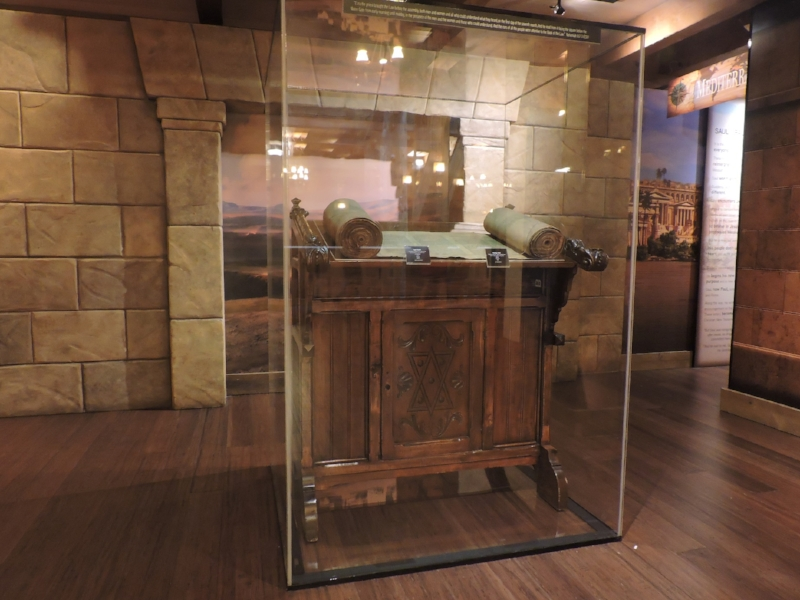 Fig 4. A 19th century Persian Torah Scroll on an early 20th century Reading Table from Poland, at the opening of the MOTB Voyage of a Book exhibit at the Ark Encounter. Photo by author, Aug. 2, 2016.
