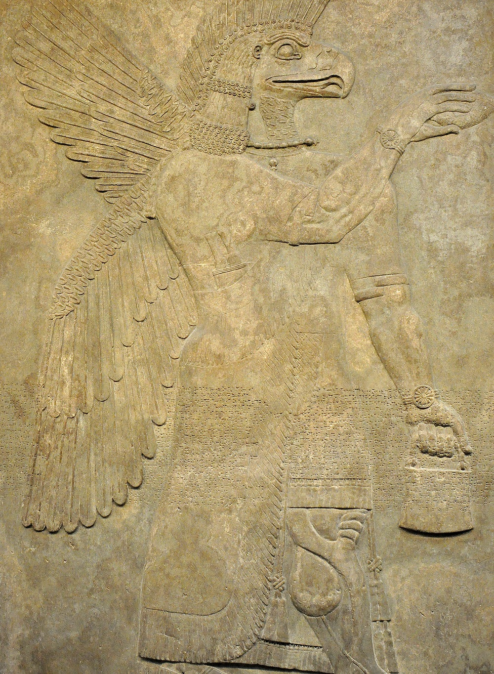 Neo-Assyrian wall relief depicting an eagle-headed apkallu (sage) | In the British Museum, from the Palace of Ashunasirpal II at Nimrud, Iraq |  Image source