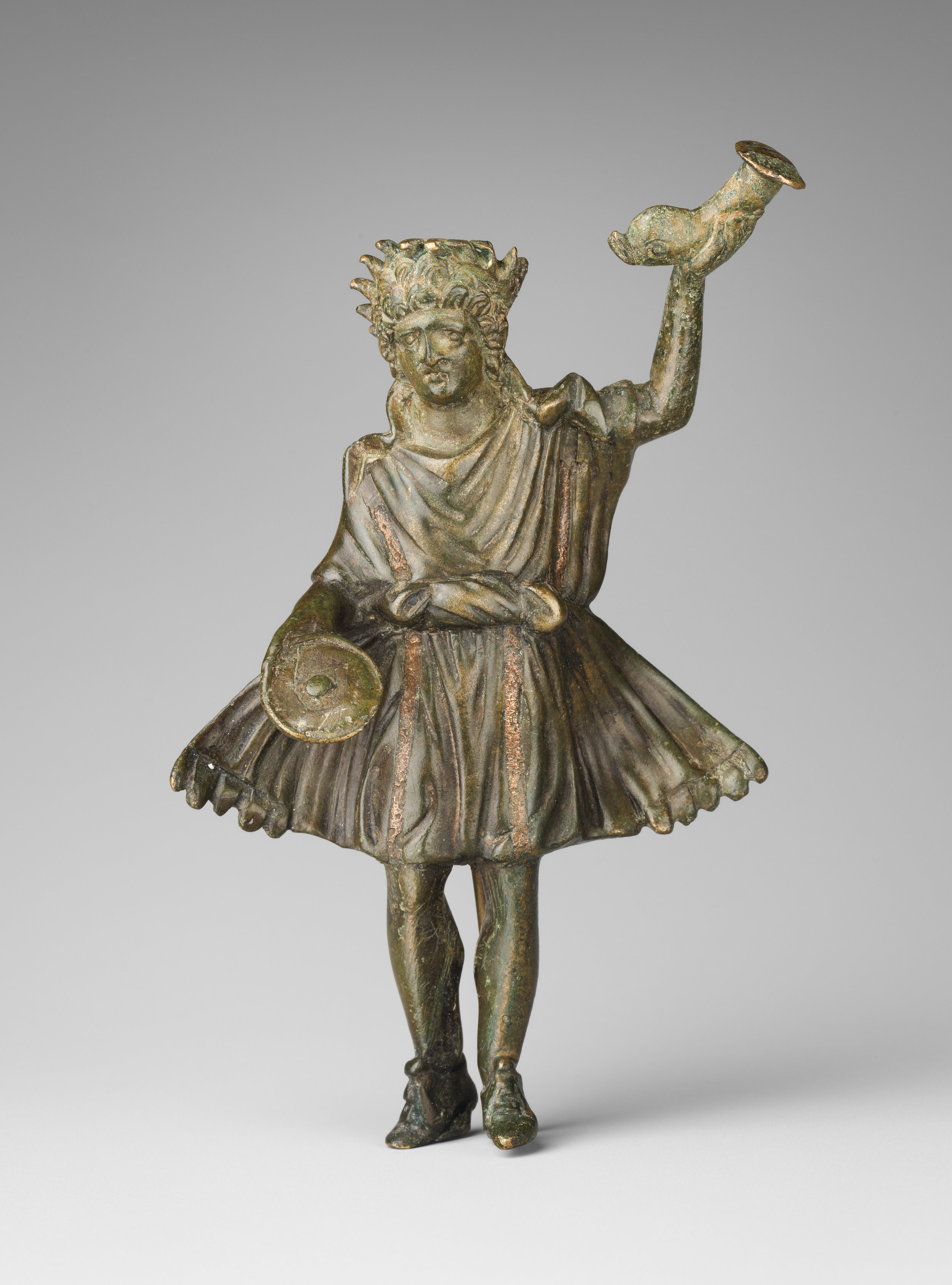 Another singular lar, with rhyton in left hand. ( Met Museum )