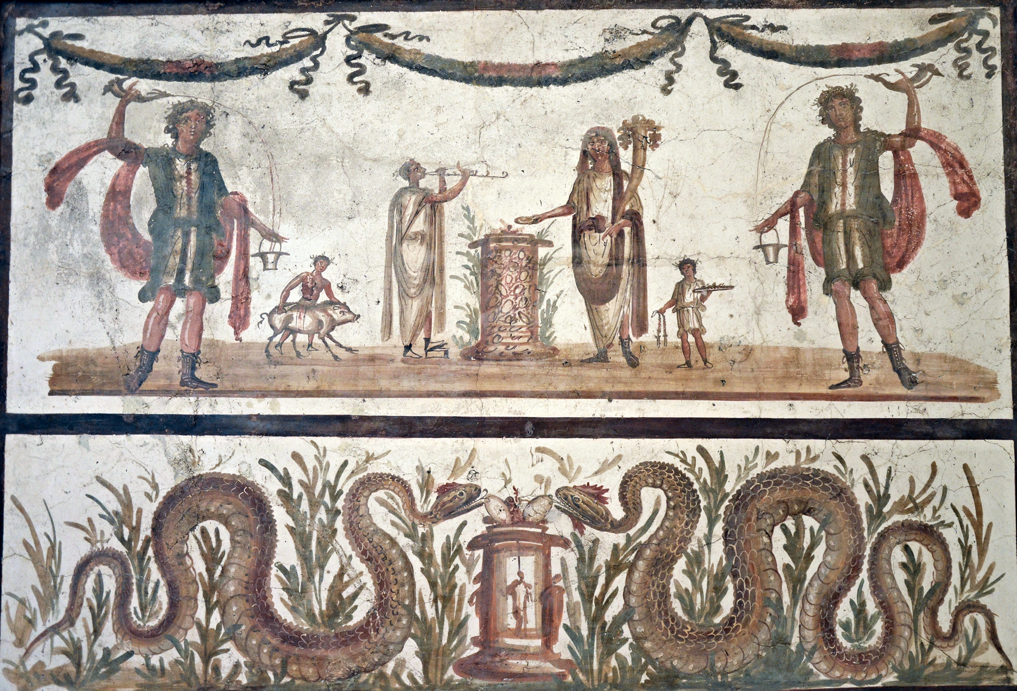 This fresco depicts the genius of the household providing an offering and sacrifice (the pig) to the lares (who are the larger figures on the left and right). Below, in a separate space, snakes (as genius loci) receive their own offering. ( Flickr courtesy of Tyler Bell )
