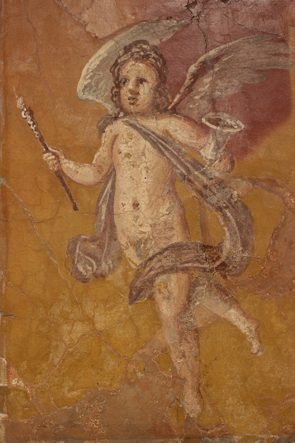 First-century CE fresco of a winged putti | From the Villa dei Papiri, Herculeaneum, currently in the Naples Archaeological Museum |  Image Source