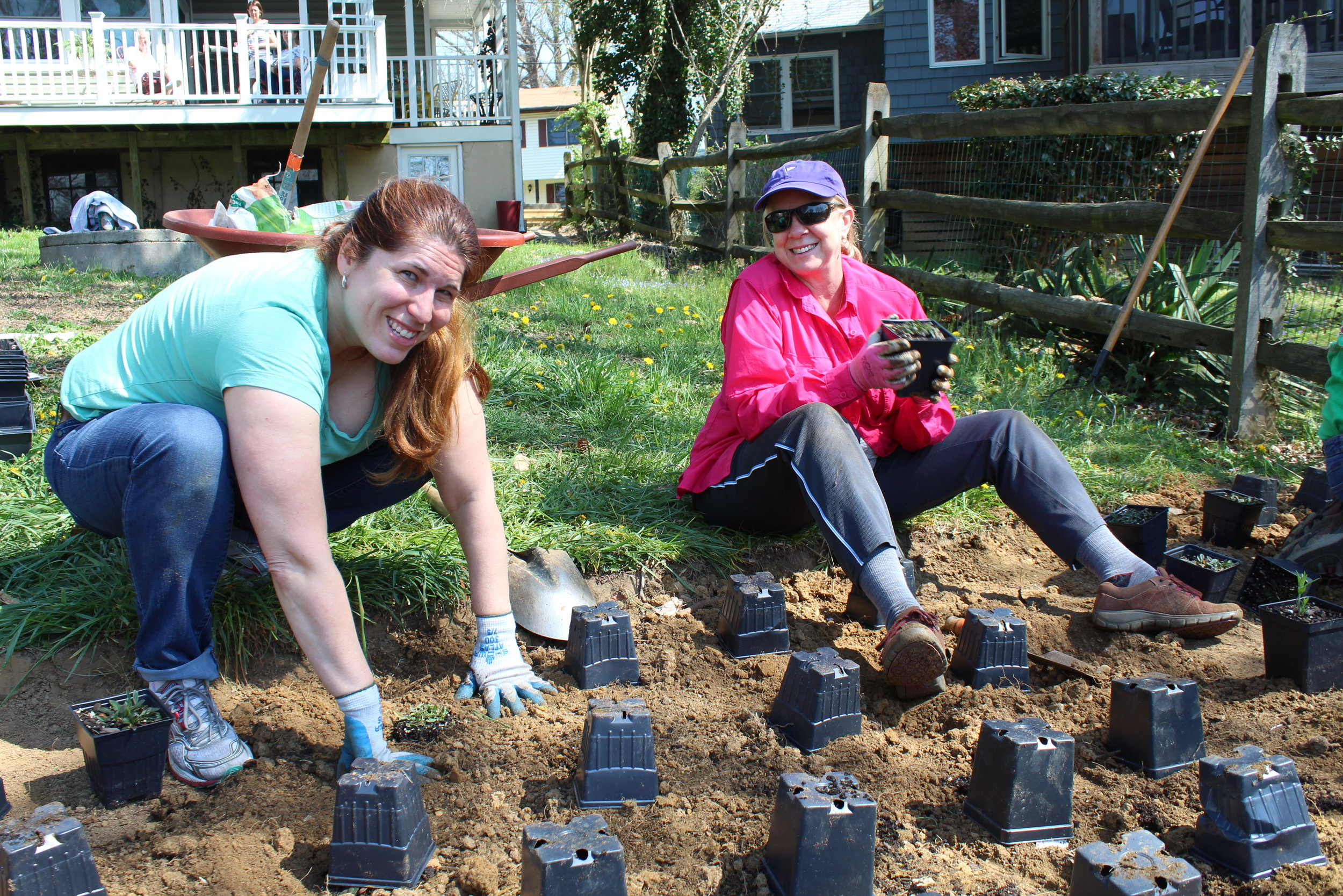 Katie Matta and Ann Brown planting natives at the Class 10 project.