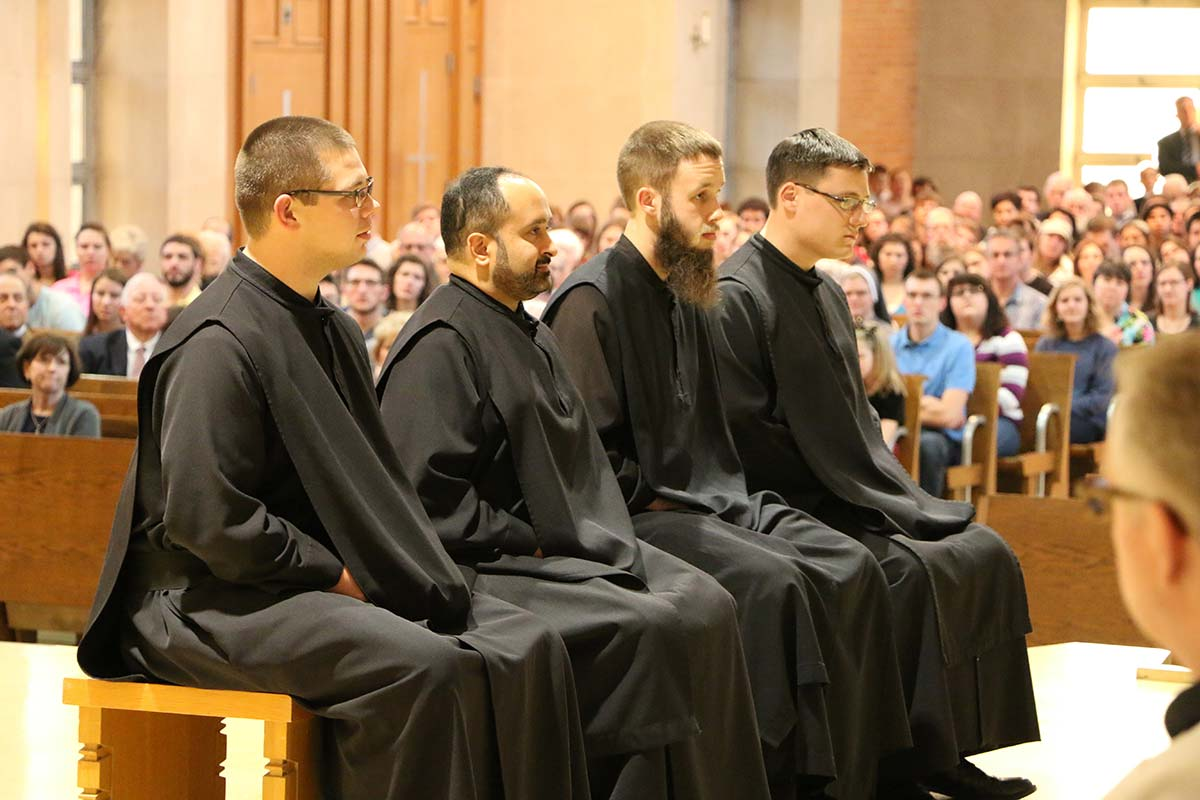 The monks sit before the Abbot, the community and the congregation.